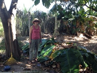 Melinda next to the compost pile she created at the demonstration garden.