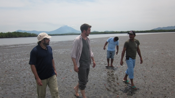 Karolo Aparicio on a field visit in the Bajo of Jiquilisco with Program and Policy Director Nathan Weller and Marvin Alvarado of Puerto Parada