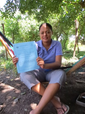 Maira proudly holds up the papers that demonstrate UDP-ABL's legal status.