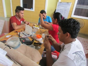 Youth Artisan Cooperative hard at work during a training workshop